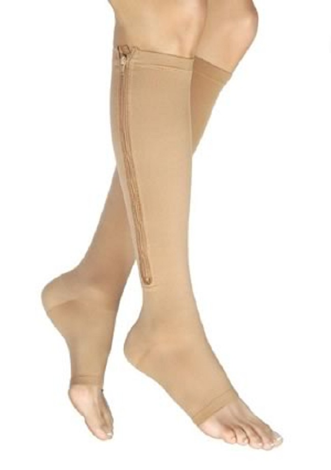b8cd7cb799 Stylish, zippered compression stockings for men and women effectively  alleviate swelling and pain in the feet and legs. Jobst Vairox Knee High  Open ...