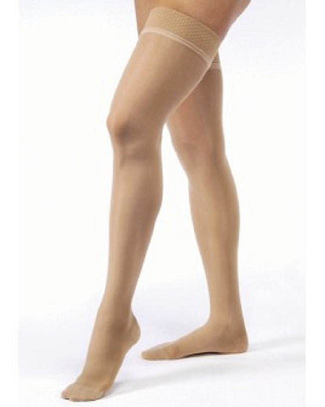 5753da3e8d7 Sheer support hosiery with a silicone dot thigh border provides a soft and  silky look and a 15-20 mmHg compression level.