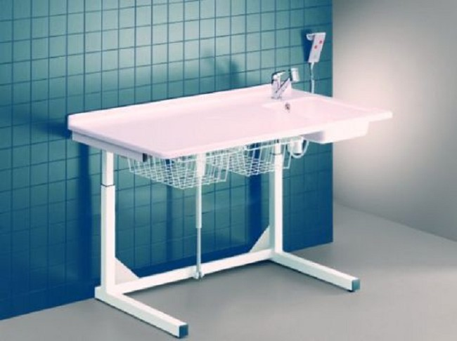 Pressalit Care Dolphin Adjustable Height Changing Table With Sink - Adjustable changing table